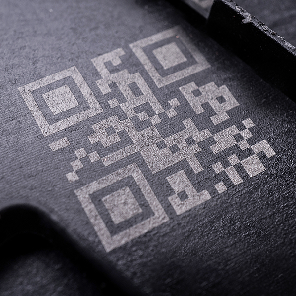 QR code on black plastic auto parts