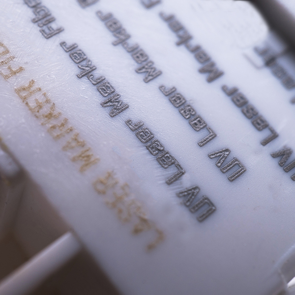 Text on white plastic
